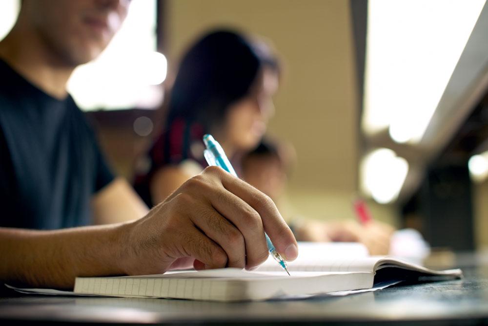 teen-hand-homework